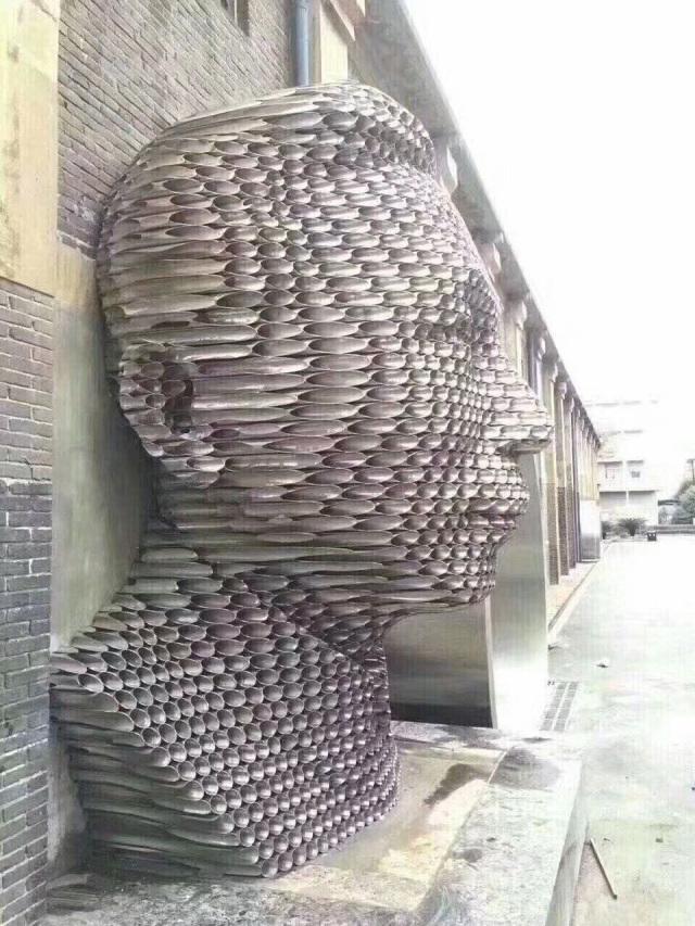 铝圆管削尖组合人头像