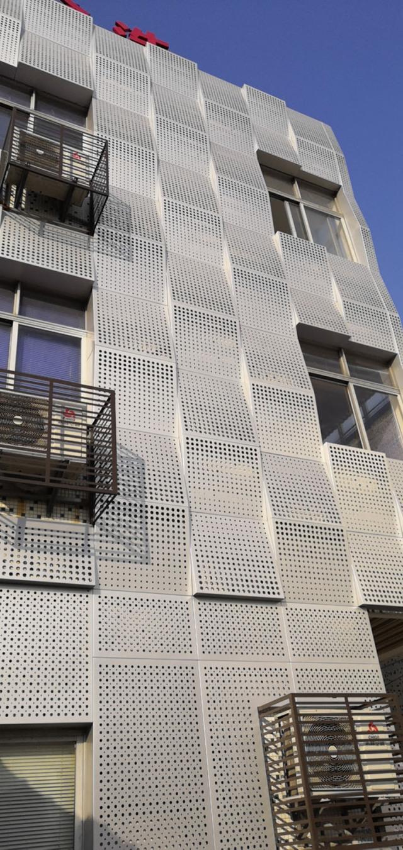 外墙冲孔波浪形渐变孔铝单板