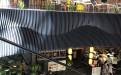 黑色弧形立面铝方通组合整体波浪造型