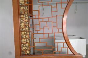 木纹色中式门洞屏风铝板