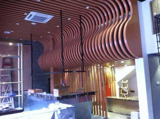 大波浪造型铝方通墙面吊顶一体化