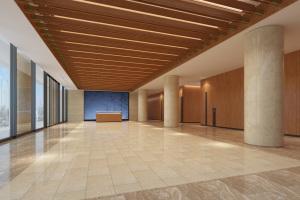 宴会厅前台签到处超有质感的仿木纹铝方通吊顶