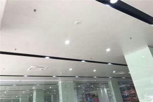 移动营业厅白色铝单板吊顶和黑色铝板灯槽