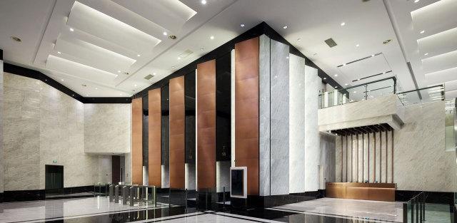 大厅主体墙面干挂石材复合铝蜂窝板