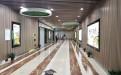地铁商铺过道墙面木纹色长城板和吊顶木纹铝方通